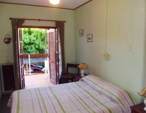 Una cama o camas en una habitación de Hostería Las Gemelas