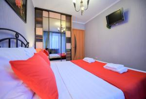 A bed or beds in a room at Five Stars Big Family