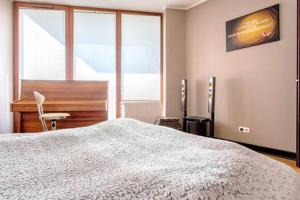 Łóżko lub łóżka w pokoju w obiekcie Cracow City Apartments Verona