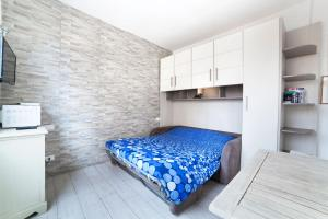 A bed or beds in a room at Studio Flat Ponte Vecchio