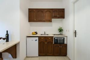 A kitchen or kitchenette at Philippos Hotel