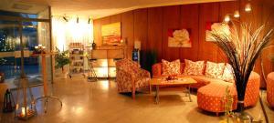 Ein Sitzbereich in der Unterkunft Hotel Heissinger