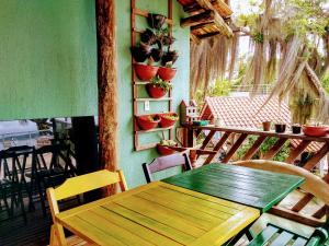 Um restaurante ou outro lugar para comer em Pousada Praia da Lagoinha