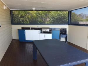 A kitchen or kitchenette at First Sun Holiday Park