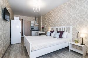 Кровать или кровати в номере Апартаменты на Красной 176