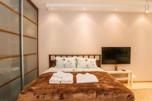 Кровать или кровати в номере Апартаментос на Маяковке