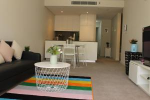 A kitchen or kitchenette at Exquisite Family Home +Parking, Close to CBD