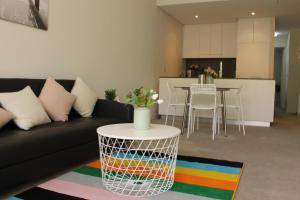 A seating area at Exquisite Family Home +Parking, Close to CBD