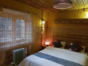 Giường trong phòng chung tại Dao Lodge