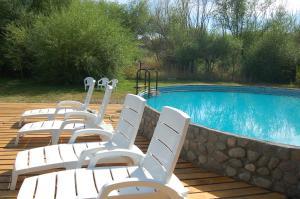 The swimming pool at or close to La Estancia