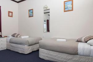 A bed or beds in a room at Moana Lodge