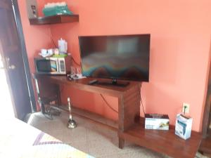 A television and/or entertainment center at Paradise Villas