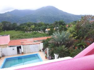A view of the pool at Paradise Villas or nearby