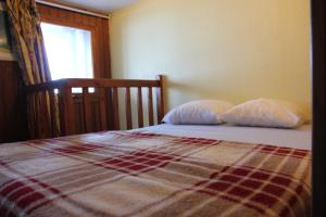 A bed or beds in a room at Silveralp