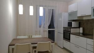 A kitchen or kitchenette at Home atmosphere