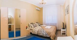 Кровать или кровати в номере Apartamentos na Kutuzovskom Prospekte