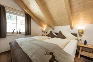 מיטה או מיטות בחדר ב-AlpenParks Hagan Lodge Altaussee