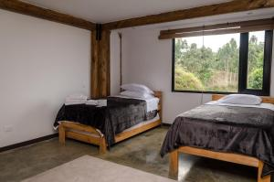 A bed or beds in a room at Casa Bambuco