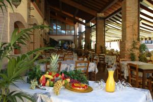 A restaurant or other place to eat at Camping Bella Italia