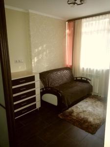 Гостиная зона в Apartment on Roz 50