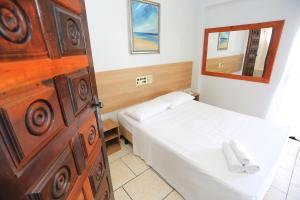 Cama ou camas em um quarto em Rede Andrade Lumar