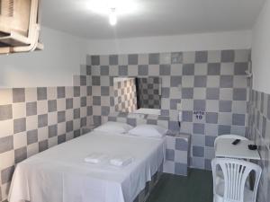Um banheiro em Pousada Dois Corações