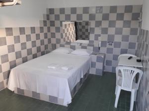 Cama ou camas em um quarto em Pousada Dois Corações