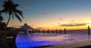 Der Swimmingpool an oder in der Nähe von Coral Princess Golf & Dive Resort
