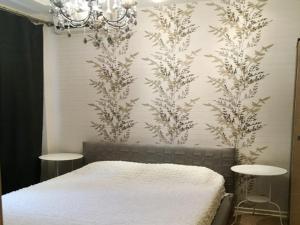 Кровать или кровати в номере Апартаменты на улице 1-ая Дубровская