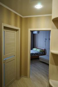 Кровать или кровати в номере Апарт отель на Куйбышева