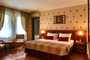 A bed or beds in a room at Elit Palas Hotel