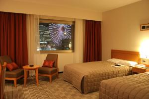 A bed or beds in a room at Navios Yokohama