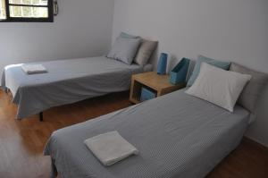 A bed or beds in a room at F! Lisbon Guest House