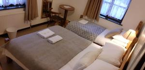 A bed or beds in a room at New Gurkha Inn