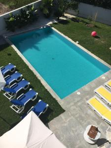 A view of the pool at Villa Oporto Beach (15min drive to Oporto) or nearby