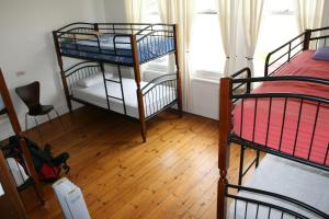 A bunk bed or bunk beds in a room at Arthouse Hostel