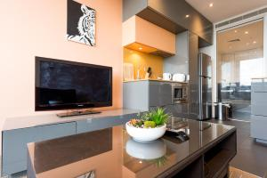 A television and/or entertainment center at Melbournian Luxury Lifestyle 1BR