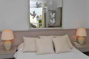A bed or beds in a room at Astir Of Paros