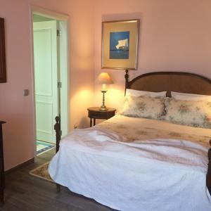 A bed or beds in a room at Casal das Oliveiras - Um alojamento de luxo