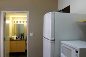 A kitchen or kitchenette at Residence & Conference Centre - Oakville