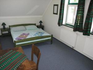 Postel nebo postele na pokoji v ubytování Novopacké Sklepy