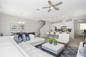 A seating area at Four Bedroom TownHome w/ game room 5128