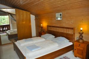 A bed or beds in a room at Chalet 3 Musketiers