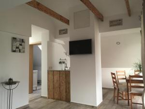 A television and/or entertainment center at Apartments Vila Cvetka Bled