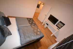 Ein Bett oder Betten in einem Zimmer der Unterkunft Madame Tower