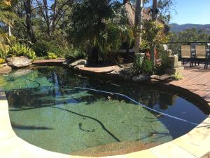 A view of the pool at Hinterland Hideaway or nearby
