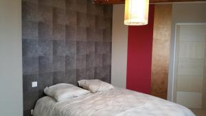 Un ou plusieurs lits dans un hébergement de l'établissement 29 color'appart