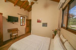 A bed or beds in a room at Carmen Hotel & Villas