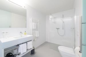 Ein Badezimmer in der Unterkunft Gasthof Pension Löwen