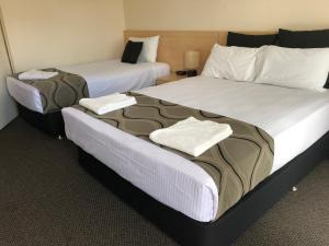 A bed or beds in a room at City Centre Motel Kempsey